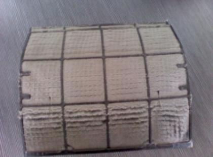 aircon plastic filter clogged with dust
