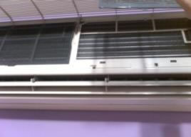 aircon front cover lifted up to access aircon plastic filter